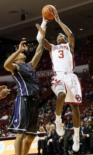 Photo - Oklahoma's Buddy Hield (3) shoots over TCU's Garlon Green (33) during an NCAA men's basketball game between the University of Oklahoma (OU) and Texas Christian University (TCU) at the Lloyd Noble Center in Norman, Okla., Monday, Feb. 11, 2013. OU won, 75-48. Photo by Nate Billings, The Oklahoman