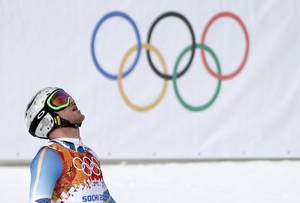 Photo - Norway's Aksel Lund Svindal reacts after finishing the men's downhill at the Sochi 2014 Winter Olympics, Sunday, Feb. 9, 2014, in Krasnaya Polyana, Russia. (AP Photo/Gero Breloer)