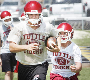 photo - Tuttle's Ethan Biddy will carry the load at running back and at middle linebacker. PHOTO BY STEVE SISNEY, THE OKLAHOMAN