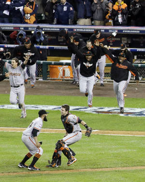 Photo -   San Francisco Giants celebrate after the Giants defeated the Detroit Tigers, 4-3, in Game 4 of baseball's World Series Sunday, Oct. 28, 2012, in Detroit. The Giants won the World Series 4-0. (AP Photo/Patrick Semansky)