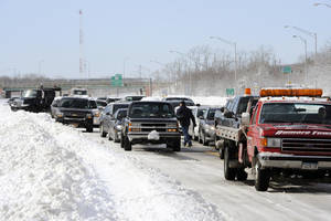 Photo - Traffic is backed up on the Long Island Expressway just west of Exit 59 Ocean Avenue as payloaders clear snow from the road after a storm, Saturday, Feb. 9, 2013, in Ronkonkoma , N.Y. (AP Photo/Kathy Kmonicek)