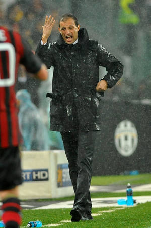 Photo - AC Milan coach Massimiliano Allegri gestures during a Serie A soccer match between Juventus and AC Milan at the Juventus stadium, in Turin, Italy, Sunday, Oct. 6, 2013. (AP Photo/Massimo Pinca)