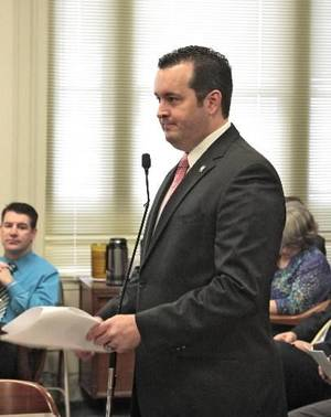 photo - Representative Sean Roberts presents HB 1621, a gun bill, to the House committee at the capitol, Wednesday, February 20, 2013. Photo By David McDaniel