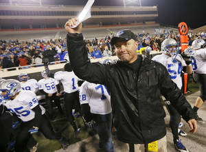 Photo - Guthrie head coach Rafe Watkins reacts as time expires in the 5A state high school football championship game between the McAlester Buffaloes and the Guthrie Bluejays at Boone Pickens Stadium in Stillwater, Okla., Saturday, Dec. 14, 2013. Guthrie won, 51-21. Photo by Nate Billings, The Oklahoman