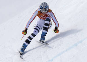 Photo - Germany's Maria Hoefl-Riesch makes a turn during the downhill portion of the women's supercombined at the Sochi 2014 Winter Olympics, Monday, Feb. 10, 2014, in Krasnaya Polyana, Russia. (AP Photo/Luca Bruno)