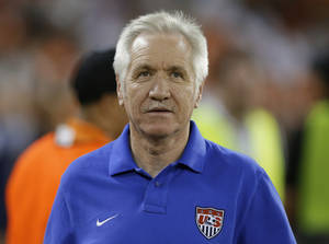 Photo - In this Sept. 3, 2013, photo, U.S. women's national soccer team coach Tom Sermanni waits for an international friendly against Mexico in Washington. U.S. Soccer says Sermanni has been fired as coach. The Americans beat China 2-0 in an exhibition game Sunday, April 6, 2014, in Commerce City, Colo. Hours later, the U.S. soccer announced the move in a news release. (AP Photo/Alex Brandon)