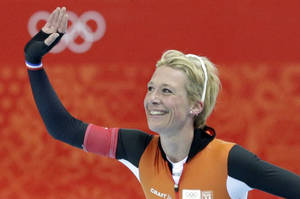 Photo - Carien Kleibeuker of the Netherlands acknowledges the crowd after competing in the women's 5,000-meter speedskating race at the Adler Arena Skating Center during the 2014 Winter Olympics in Sochi, Russia, Wednesday, Feb. 19, 2014. (AP Photo/Matt Dunham)