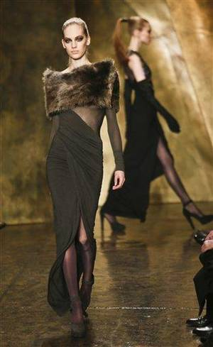 Photo - Fashion from the Fall 2013 collection of Donna Karan New York is modeled on Monday, Feb. 11, 2013 in New York.  (AP Photo/Bebeto Matthews)