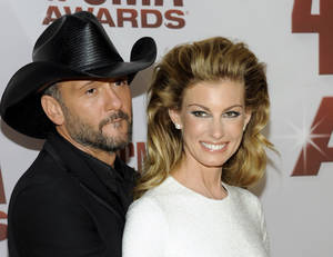 "Photo -   FILE - This Nov. 9, 2011 file photo shows country singers Tim McGraw, left, and his wife Faith Hill at the 45th Annual CMA Awards in Nashville. will be doing a 10-weekend run of shows at The Venetian starting Dec. 7 through next April. The couple planned to announce the news Tuesday, Aug. 7, 2012, during a news conference at the hotel. The show is called ""Soul2Soul,"" named after their hugely successful co-headlining tours in 2000 and 2006. The Vegas shows will mark the first time in six years that McGraw and Hill have performed together in the United States. Pre-sale tickets go on sale Wednesday and open to the general public on Monday, Aug. 13. (AP Photo/Evan Agostini, file)"