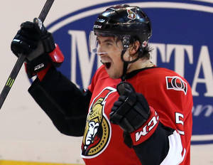 Photo - Ottawa Senators Cody Ceci, center, celebrates his first NHL goal in overtime to beat St Louis Blues 3-2, in Ottawa Monday, Dec. 16, 2013. (AP Photo/The Canadian Press, Fred Chartrand)