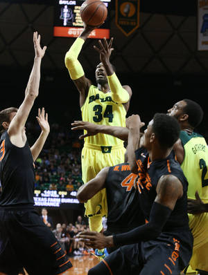 Photo - Baylor forward Cory Jefferson (34) scores past Oklahoma State forward/center Mason Cox (53), left, and other players in the second half of an NCAA college basketball game, Monday, Feb. 17, 2014, in Waco, Texas. Baylor won in overtime 70-64. (AP Photo/Waco Tribune Herald, Rod Aydelotte)