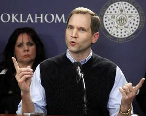 Photo - Dan Skerbitz, director of Personhood Oklahoma, gestures as he speaks at a news conference in Oklahoma City, Thursday, March 1, 2012. The group, that wants to ban abortions in Oklahoma, is launching a signature drive with the goal of amending the state Constitution to define a fertilized human egg as a human being. AP Photo