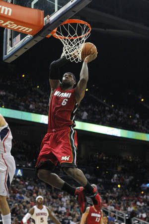 Photo -   Miami Heat forward LeBron James (6) slams in the first half of a preseason NBA basketball game Sunday, Oct. 7, 2012 in Atlanta. (AP Photo/Todd Kirkland)