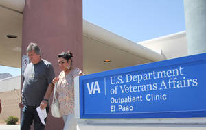 Photo - In this June 9, 2014, photo, David and Marianne Trujillo exit the Vetaran Affairs facility in El Paso, Texas. Some Veterans Affairs facilities in Texas have among the longest wait-times in the nation for those trying to see a doctor for the first time, according to federal data. It's not just veterans who sometimes have to wait for health care. Depending on where you live and what kind of care you want, in parts of the country it's not always easy for new patients to get a quick appointment.  (AP Photo/Juan Carlos Llorca)