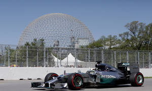 Photo - Mercedes driver Lewis Hamilton, from Great Britain, drives through the course during a practice session at the Canadian Grand Prix, Saturday, June 7, 2014, in Montreal. (AP Photo/AP Photo/David J. Phillip)