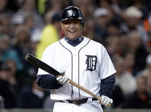 Photo -   Detroit Tigers' Miguel Cabrera smiles while being intentionally walked by the Oakland Athletics during the third inning of a baseball game in Detroit, Wednesday, Sept. 19, 2012. (AP Photo/Paul Sancya)
