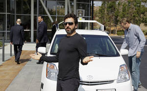 Photo - FILE - In this Sept. 25, 2012, file photo, Google co-founder Sergey Brin gestures after riding in a driverless car with officials, to a bill signing for driverless cars at Google headquarters in Mountain View, Calif. Google engineers say they have turned a corner in their pursuit of creating a car that can drive itself. Test cars have been able to navigate freeways comfortably for a few years. On Monday, April 28, 2014, Google said the cars can now negotiate thousands of urban situations that would have stumped them a year or two ago.  (AP Photo/Eric Risberg, File)