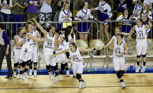 Photo - Okarche players  celebrate their victory in the Class A girls state championship game. The Lady Warriors beat Cheyenne/Reydon, the team they lost to in the area finals last week.Photo by Bryan Terry, The Oklahoman
