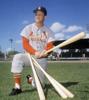 Photo - FILE- In this March 23, 1964 file photo, Stan Musial visits his former teammates at the St. Louis Cardinals spring training baseball camp in Florida. Musial, one of baseball's greatest hitters and a Hall of Famer with the Cardinals for more than two decades, died Saturday, Jan. 19, 2013, the team announced. He was 92.  (AP Photo/File)