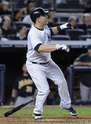 photo -   New York Yankees' Russell Martin watches his solo home run off Oakland Athletics relief pitcher Sean Doolittle in the 10th inning that gave the Yankees a 2-1 win in a baseball game Friday, Sept. 21, 2012, at Yankee Stadium in New York. (AP Photo/Kathy Kmonicek)