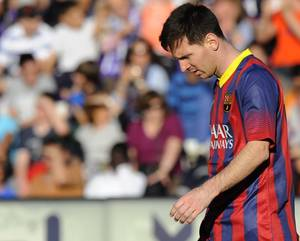 Photo - FC Barcelona's Lionel Messi from Argentina is seen during a Spanish La Liga soccer match against Real Valladolid at the Jose Zorrilla stadium in Valladolid, Spain on Saturday March 8, 2014. (AP Photo/Israel L. Murillo)
