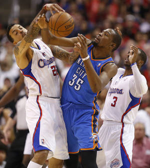 Photo - Oklahoma City's Kevin Durant (35) loses the ball between Los Angeles' Matt Barnes (22) and Chris Paul (3) during Game 4 of the Western Conference semifinals in the NBA playoffs between the Oklahoma City Thunder and the Los Angeles Clippers at the Staples Center in Los Angeles, Sunday, May 11, 2014. Photo by Nate Billings, The Oklahoman