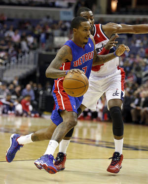 Photo - Detroit Pistons guard Brandon Jennings (7) gets past Washington Wizards guard John Wall (2) in the first half of an NBA basketball game, Saturday, Jan. 18, 2014, in Washington. (AP Photo/Alex Brandon)