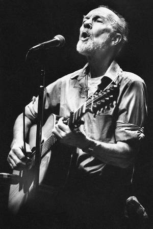 Photo -  This Feb. 25, 1984, file photo shows folk singer Pete Seeger performing in a one-man benefit concert in Berkeley, Calif., at the Berkeley Community Theater. Hundreds of friends and fans joined in song Sunday, Feb. 2, 2014, to honor Seeger, doing what the folk singer loved best. Seeger died Jan. 27 at age 94; no services were planned. AP file photo  <strong>Mark Costantini -  AP </strong>