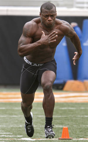 Photo - Kendall Hunter runs for his 40 yard time during the NFL pro day at Oklahoma State University on Wednesday, March 9, 2011, in Stillwater, Okla.  Photo by Chris Landsberger, The Oklahoman