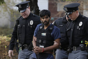 photo -   Raghunandan Yandamuri is escorted to a Montgomery County district court for a preliminary hearing Wednesday, Nov. 28, 2012, in Bridgeport, Pa. Investigators said Yandamuri killed 10-month-old Saanvi Venna and her grandmother Satyavathi Venna in a botched ransom kidnapping. He is being held without bail on murder, kidnapping and other charges. (AP Photo/Matt Rourke)  
