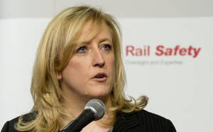 Photo -  Canadian Transport Minister Lisa Raitt announces new railway safety measures during a news conference Wednesday in Ottawa. Raitt said DOT-111 tankers, which are used to carry crude oil and ethanol and are prone to rupture, must be retired or retrofitted within three years. AP Photo/The Canadian Press  <strong>Adrian Wyld -  AP </strong>
