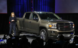 Photo - Incoming General Motors CEO Mary Barra introduces the 2015 GMC Canyon during the media previews for the North American International Auto Show, Sunday, Jan. 12, 2014, in Detroit. (AP Photo/Paul Sancya)