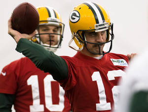Photo - Green Bay Packers NFL football quarterback Aaron Rodgers (12) practices  in Ashwaubenon, Wisc., on Tuesday, Nov. 26, 2013.  (AP Photo/The Green Bay Press-Gazette, Lukas Keapproth) NO SALES