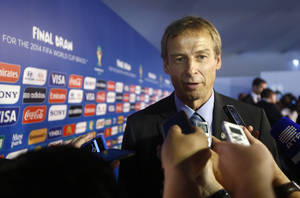 Photo - United States head coach Juergen Klinsmann from Germany answers journalists' question after the draw ceremony for the 2014 soccer World Cup in Costa do Sauipe near Salvador, Brazil, Friday, Dec. 6, 2013. (AP Photo/Victor R. Caivano)