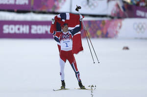 Photo - Norway's Ola Vigen Hattestad celebrates winning the gold after the men's final of the cross-country sprint at the 2014 Winter Olympics, Tuesday, Feb. 11, 2014, in Krasnaya Polyana, Russia. (AP Photo/Matthias Schrader)