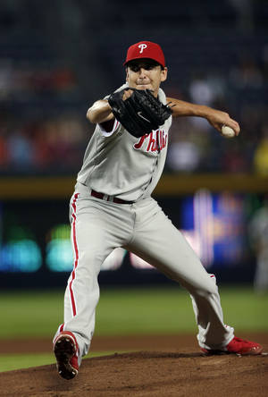 Photo - Philadelphia Phillies starting pitcher John Lannan (27) works in the first inning of a baseball game against the Atlanta Braves in Atlanta, Wednesday, Aug. 14, 2013.   (AP Photo/John Bazemore)