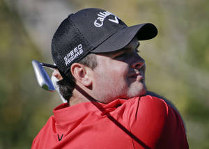Photo - Patrick Reed watches his tee shot on the third hole during the second round of the Humana Challenge golf tournament at the La Quinta Country Club on Friday, Jan. 17, 2014, in La Quinta, Calif. (AP Photo/Chris Carlson)