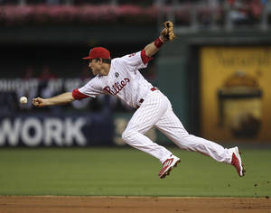 Photo - Philadelphia Phillies' second baseman Chase Utley can't get a hand on Washington Nationals' Denard Span's hit during the third inning of a baseball game in Philadelphia, Friday, July 11, 2014. (AP Photo/Philadelphia Daily News, Steven M. Falk)