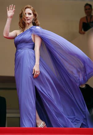 Photo - Actress Jessica Chastain poses for photographers as she arrives for the screening of Foxcatcher at the 67th international film festival, Cannes, southern France, Monday, May 19, 2014. (AP Photo/Alastair Grant)