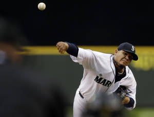 Photo - Seattle Mariners starting pitcher Felix Hernandez (34) throws in the third inning of a baseball game against the Los Angeles Angels, Saturday, April 27, 2013, in Seattle. (AP Photo/Ted S. Warren)