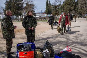 Photo - Ukrainian servicemen pile up their things after leaving the Ukrainian navy headquarters stormed by Crimean pro-Russian self-defense forces in Sevastopol, Crimea, Wednesday, March 19, 2014. Crimea's self-defense forces on Wednesday stormed the Ukrainian navy headquarters in the Black Sea port of Sevastopol, taking possession without resistance a day after Russia signed a treaty with local authorities to annex the region.  (AP Photo/Andrew Lubimov)
