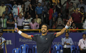 Photo - Janko Tipsarevic of Serbia celebrates his win against Roberto Bautista Agut of Spain during their final match of the ATP Chennai Open tennis tournament in Chennai, India, Sunday, Jan. 6, 2013. (AP Photo/Arun Sankar K.)
