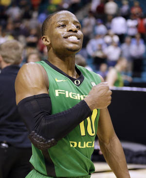 Photo - Oregon's Jonathan Loyd reacts at the end of the game after Oregon defeated UCLA 78-69 in the championship NCAA college basketball game at the Pac-12 Conference tournament, Saturday, March 16, 2013, in Las Vegas. (AP Photo/Julie Jacobson) ORG XMIT: NVJJ132