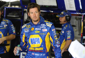 Photo - Martin Truex, Jr. walks in the garage during practice for the NASCAR Sprint Cup Series auto race at Texas Motor Speedway, Friday, April 13, 2012, in Fort Worth, Texas. (AP Photo/Ralph Lauer) ORG XMIT: TMS124