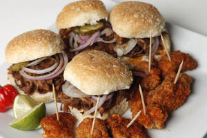"Photo - Pulled pork sliders and Mr. Cluck's Chicken Shack bites will work for your ""Lost"" watch party. Photo by Doug Hoke"