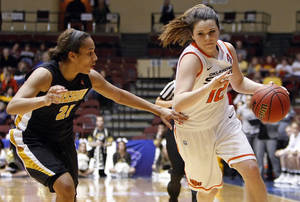 photo - OSU's Jordan Schultz (12) dribbles past Missouri's Sydney Crafton (21) during the Big 12 tournament women's college basketball game between the Oklahoma State University Cowgirls and the University of Missouri Tigers at Municipal Auditorium in Kansas City, Mo., Wednesday, March 7, 2012. Mizzou won, 72-68. Photo by Nate Billings, The Oklahoman