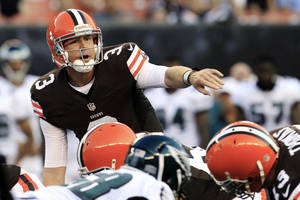 photo -   FILE - In this Aug. 24, 2012, file photo, Cleveland Browns quarterback Brandon Weeden (3) gets ready to take a snap during a preseason NFL football game against the Philadelphia Eagles in Cleveland. Coming off a dismal 4-12 season, their eighth in nine years of at least 10 losses, the Browns enter 2012 with high hopes and low expectations. The Browns are scheduled to begin their regular season on Sept. 9 at home against the Philadelphia Eagles. (AP Photo/Tony Dejak, File)
