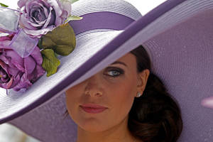 Photo - Tamara Sorreoo, from Austin, Tx., shows off her Derby hat before the 137th Kentucky Derby horse race at Churchill Downs Saturday, May 7, 2011, in Louisville, Ky. (AP Photo/Denis Paquin) <strong>Denis Paquin - AP</strong>