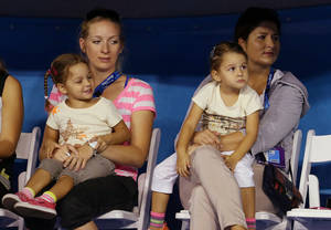 Photo - FILE - This Jan. 12, 2013 photo shows Mirka, right, wife of Switzerland's Roger Federer watches with her daughters Myla and Charlene and a unidentified woman during a exhibition match during the Kids Tennis Day at Melbourne Park ahead of the Australian Open tennis championship in Melbourne, Australia. Federer announced on Twitter that he and his wife are expecting another child next year.    (AP Photo/Aaron Favila, File)