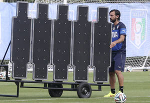 Photo - Italy's Andrea Pirlo moves a barrier that he will use to practice his free kicks during a training session in Mangaratiba, Brazil, Wednesday, June 11, 2014. Italy will play in group D at the World Cup. (AP Photo/Antonio Calanni)